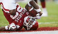 Arkansas running back Trelon Smith (22) scores, Saturday, November 21, 2020 during the third quarter of a football game at Donald W. Reynolds Razorback Stadium in Fayetteville. Check out nwaonline.com/201122Daily/ for today's photo gallery. <br /> (NWA Democrat-Gazette/Charlie Kaijo)