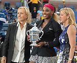 Serena Williams (USA) (black jacket) laughs with Martina Navratilova and Chris Evert after her victory over Caroline Wozniacki (DEN) at the US Open being played at USTA Billie Jean King National Tennis Center in Flushing, NY on September 7, 2014