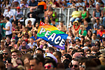 """© Joel Goodman - 07973 332324 - all rights reserved . 03/07/2010 . London , UK . A rainbow flag reading """" PEACE """" is waved above the crowd in Trafalgar Square . Annual London Pride march and demonstration through the centre of London . Photo credit : Joel Goodman"""