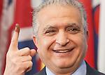 Iraq Ambassador to UN Mohammad Ali Al-Hakim showing his vote