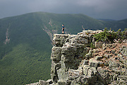 Pemigewasset Wilderness - A hiker enjoys the views from the summit of Bondcliff  during the summer months. Located in the White Mountains, New Hampshire USA along the Bondcliff Trail.