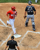 22 June 2014: Washington Nationals catcher Sandy Leon crosses the plate to score in the 5th inning on a Denard Span double against the Atlanta Braves at Nationals Park in Washington, DC. The Nationals defeated the Braves 4-1 to split their 4-game series and take sole possession of first place in the NL East. Mandatory Credit: Ed Wolfstein Photo