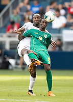 KANSAS CITY, KS - JUNE 26: Sheldon Holder #9 and Daneil Cyrus #5 go after a header during a game between Guyana and Trinidad