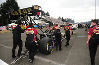 Aug. 5, 2011; Kent, WA, USA; Crew members for NHRA top fuel dragster driver Del Worsham during qualifying for the Northwest Nationals at Pacific Raceways. Mandatory Credit: Mark J. Rebilas-