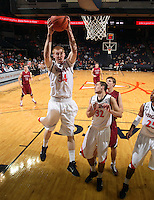 Nov 6, 2010; Charlottesville, VA, USA; Virginia Cavaliers f James Johnson (34) grabs the rebound Saturday afternoon in exhibition action at John Paul Jones Arena. The Virginia men's basketball team recorded an 82-50 victory over Roanoke College.
