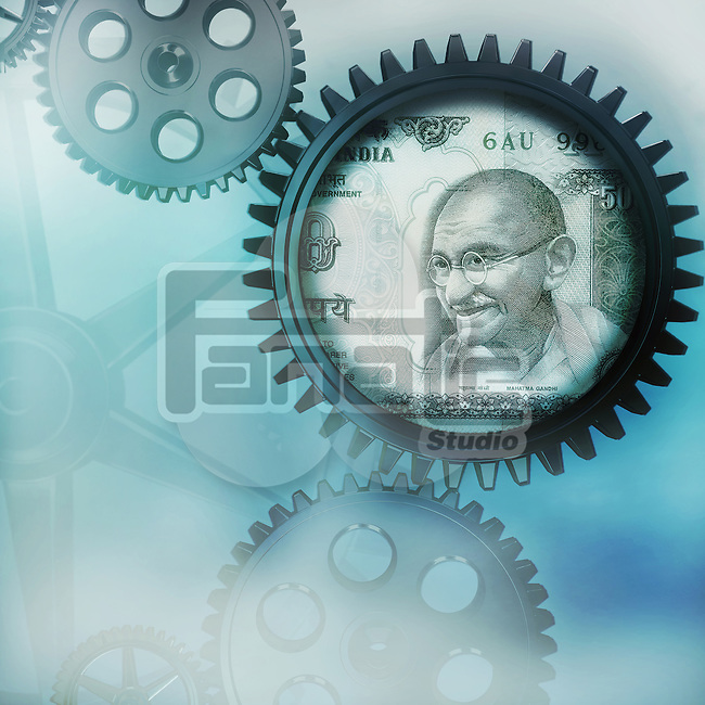 Indian currency on cog