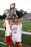 Caitlyn McFadden (right) raises the trophy with a teammate after the NCAA Championship held in Johnny Unitas Stadium at Towson University in Towson, MD.  Maryland defeated Northwestern, 13-11, to win the title.