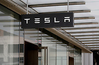 NEW YORK - NEW YORK - MARCH 24: The Tesla sign is seen at its store in Lower Manhattan on March 24, 2021 in New York. Tesla Inc said it bought $1.5 billion worth of bitcoin and would soon accept it as a form of payment for its cars. (Photo by John Smith/VIEWpress)