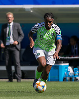 GRENOBLE, FRANCE - JUNE 12: Desire Oparanozie #9 of the Nigerian National Team dribbles at midfield during a game between Korea Republic and Nigeria at Stade des Alpes on June 12, 2019 in Grenoble, France.