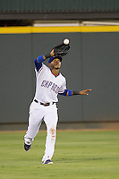 Round Rock Express outfielder Engel Beltre (7) makes a catch against the Oklahoma City RedHawks during the Pacific Coast League baseball game on August 25, 2013 at the Dell Diamond in Round Rock, Texas. Round Rock defeated Oklahoma City 9-2. (Andrew Woolley/Four Seam Images)
