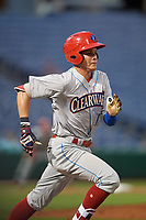 Clearwater Threshers right fielder Simon Muzziotti (12) runs to first base during a Florida State League game against the Dunedin Blue Jays on April 4, 2019 at Spectrum Field in Clearwater, Florida.  Dunedin defeated Clearwater 11-1.  (Mike Janes/Four Seam Images)