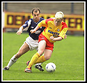 26/04/2003                   Copyright Pic : James Stewart.File Name : stewart-falkirk v ayr 15.MARK MCCALL SHIELDS THE BALL FROM JAMIE MCQUILKEN.....James Stewart Photo Agency, 19 Carronlea Drive, Falkirk. FK2 8DN      Vat Reg No. 607 6932 25.Office     : +44 (0)1324 570906     .Mobile  : +44 (0)7721 416997.Fax         :  +44 (0)1324 570906.E-mail  :  jim@jspa.co.uk.If you require further information then contact Jim Stewart on any of the numbers above.........