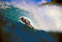 A surfer surfing at Honolua Bay on Maui