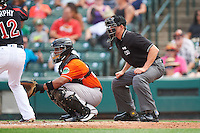 Norfolk Tides catcher Audry Perez (24) and umpire Shane Livensparger during against the Rochester Red Wings on July 17, 2016 at Frontier Field in Rochester, New York.  Rochester defeated Norfolk 3-2.  (Mike Janes/Four Seam Images)