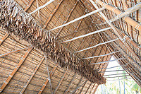 The interior of a traditional thatched hale (house or structure) at Pu'uhonua o Honaunau, Big Island.