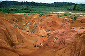 Ouro Verde, Xingu, Brazil. Open Garimpo illegal prospector gold mine pit with garimpeiros using high-pressure hoses.