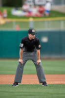 Third base umpire Brett Terry handles the calls on the bases during the game between the Salt Lake Bees and the El Paso Chihuahuas at Smith's Ballpark on July 5, 2018 in Salt Lake City, Utah. El Paso defeated Salt Lake 3-2. (Stephen Smith/Four Seam Images)