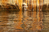 Pictured Rocks cliffs- with the color of the rocks reflecting in Lake superior