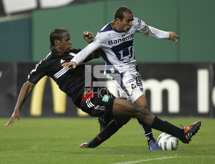 6 April 2005.  DC United's David Stokes (2) tries to tackle the ball away from Pumas UNAM forward Ailton da Silva (10) during a CONCACAF Champion's Cup game at RFK Stadium in Washington, DC.