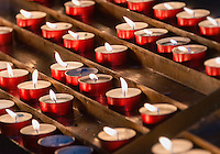 Devotional prayer candles in a Catholic church