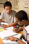 Education High School Mathematics class two male students conferring about work vertical
