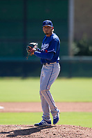 Los Angeles Dodgers pitcher Juan Morillo (8) prepares to deliver a pitch to the plate during an Instructional League game against the Chicago White Sox on September 30, 2017 at Camelback Ranch in Glendale, Arizona. (Zachary Lucy/Four Seam Images)