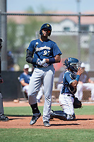 Milwaukee Brewers first baseman Ernesto Martinez (97) in front of catcher Alison Quintero (66) during an Instructional League game against the San Diego Padres at Peoria Sports Complex on September 21, 2018 in Peoria, Arizona. (Zachary Lucy/Four Seam Images)