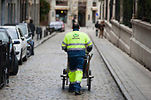 An employee of private contractor Inagra back at work in Granada, Spain, after an unsuccessful 13 day strike by street cleaners and refuse collectors over cuts to wages and holidays and an increased working week.  The company is a subsidiary of Cespa, the ninth largest waste company in Europe, itself a division of Spanish construction group Ferrovial.