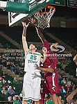 North Texas Mean Green forward Niko Stojiljkovic (25) and Troy Trojans forward Tim Owens (42) in action during the game between the Troy Trojans and the University of North Texas Mean Green at the North Texas Coliseum,the Super Pit, in Denton, Texas. UNT defeats Troy 87 to 65.....