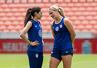 HOUSTON, TX - JUNE 9: Christen Press #23 and Lindsey Horan #9 of the USWNT talk after a training session at BBVA Stadium on June 9, 2021 in Houston, Texas.