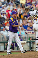 LSU Tigers Head Coach Paul Mainieri (1) walks out to the mound against the TCU Horned Frogs in the NCAA College World Series on June 14, 2015 at TD Ameritrade Park in Omaha, Nebraska. TCU defeated LSU 10-3. (Andrew Woolley/Four Seam Images)