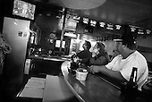 Wasco, California.USA.March 17, 2003..The clients in Tommy's bar listen to the national address by US President George W. Bush giving Saddam Hussein a 48-hour ultimatum to leave Iraq.r.