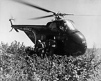 U. S. Marines of the First Marine Div. Reconnaissance Co. make the first helicopter invasion on Hill 812, to relieve the ROK Eighth Div., during the renewed fighting in Korea.  September 20, 1951. T. G. Donegan. (Navy)<br /> NARA FILE #:  080-G-433340<br /> WAR & CONFLICT BOOK #:  1430