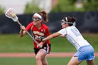 Kara Cannizzaro (15) of North Carolina defends Amanda Spinnenweber (23) of Maryland during the ACC women's lacrosse tournament finals in College Park, MD.  Maryland defeated North Carolina, 10-5.