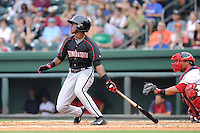 Shortstop Tim Anderson (2) of the Kannapolis Intimidators hits in a game against the Greenville Drive on Monday, August 5, 2013, at Fluor Field at the West End in Greenville, South Carolina. Anderson was a first-round pick by the Chicago White Sox in the 2013 First-Year Player Draft. Kannapolis won, 3-0. (Tom Priddy/Four Seam Images)