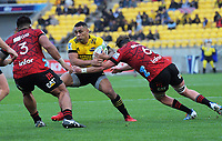 Hurricanes' Ngani Laumape is tackled during the Super Rugby Aotearoa match between the Hurricanes and Crusaders at Sky Stadium in Wellington, New Zealand on Saturday, 21 June 2020. Photo: Dave Lintott / lintottphoto.co.nz