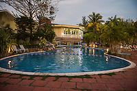 Honduras, Roatan Island, Fantasy Island Resort, Caribbean. The hotel pool in the evening.
