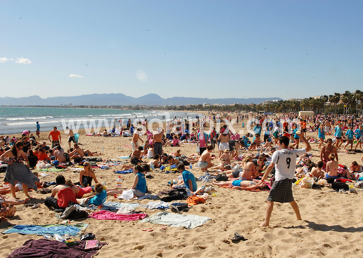 **ALL ROUND EXCLUSIVE PICTURES FROM SOLARPIX.COM**.**WORLDWIDE SYNDICATION RIGHTS**.PIctures show the warm-up to tonight's festivities at Salou fest 2010, in Salou near Barcelona, Spain, where up to 5000 British students take part in sports in the daytime, and then begin drinking on the beach to party until the early hours of the morning. Salou, Spain. 31 March 2010..This pic: Saloufest 2010, students start to gather on the beach in preparation for the night's festivities..JOB REF: 11025 NSP    DATE: 31_03_2010.**MUST CREDIT SOLARPIX.COM OR DOUBLE FEE WILL BE CHARGED**.**MUST AGREE FEE BEFORE ONLINE USAGE**.**CALL US ON: +34 952 811 768 or LOW RATE FROM UK 0844 617 7637**