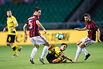 Borussia Dortmund Defender Marc Bartra (C) trips up with AC Milan Midfielder Giacomo Bonaventura (L) during the International Champions Cup 2017 match between AC Milan vs Borussia Dortmund at University Town Sports Centre Stadium on July 18, 2017 in Guangzhou, China. Photo by Marcio Rodrigo Machado / Power Sport Images