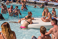 Las Vegas, Nevada.  Millennials Relaxing at the Pool, The Linq Hotel.