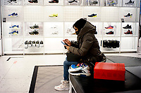 NEW YORK, NEW YORK - FEBRUARY 22: A woman try some shoes in a Nike store on February 22, 2021 in New York. NIKE, Inc. (NYSE:NKE) will trade ex-dividend in the next days , being NIKE's earnings almost flat over the past five years.  (Photo by John Smith/VIEWpress)