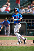 Iowa Cubs third baseman Chris Dominguez (18) follows through on a swing during a game against the Memphis Redbirds on May 29, 2017 at AutoZone Park in Memphis, Tennessee.  Memphis defeated Iowa 6-5.  (Mike Janes/Four Seam Images)