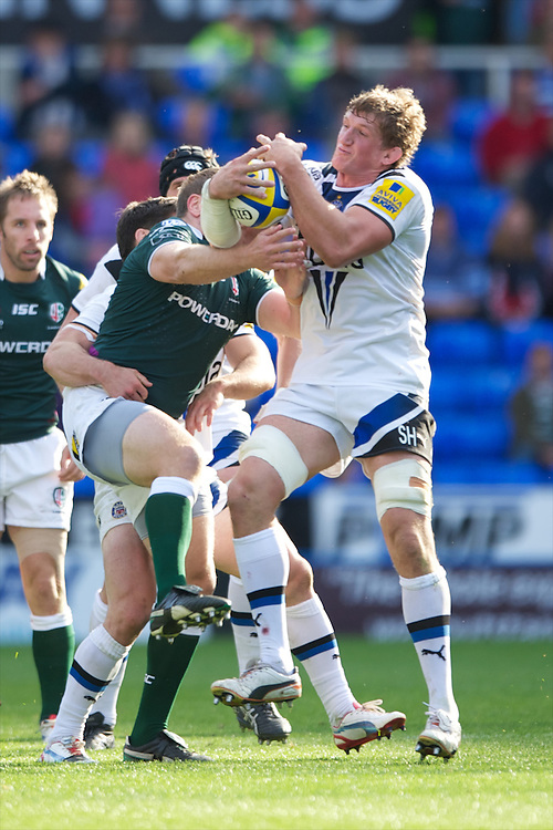 Stuart Hooper of Bath Rugby (right) beats David Paice of London Irish to the high ball during the Aviva Premiership match between London Irish and Bath Rugby at the Madejski Stadium on Saturday 22nd September 2012 (Photo by Rob Munro)