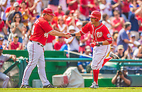 27 July 2013: Washington Nationals shortstop Ian Desmond gets a handshake from third base coach Trent Jewett while rounding the bases after hitting a solo home run against the New York Mets at Nationals Park in Washington, DC. The Nationals defeated the Mets 4-1. Mandatory Credit: Ed Wolfstein Photo *** RAW (NEF) Image File Available ***