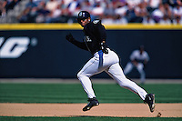 SEATTLE, WA - Ken Griffey Jr. of the Seattle Mariners runs the bases during a game at Safeco Field in Seattle, Washington on July 15, 1999. Photo by Brad Mangin