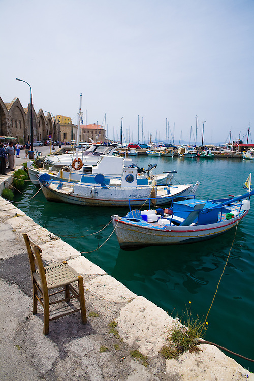 The harbor at Chania is filled with Greek boats tied to the dock.