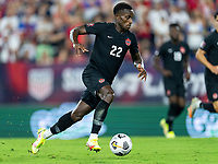 NASHVILLE, TN - SEPTEMBER 5: Richie Laryea #22 of Canada dribbles during a game between Canada and USMNT at Nissan Stadium on September 5, 2021 in Nashville, Tennessee.