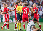 Players of FC Bayern Munich argue with referee Viktor Kassai during their 2016-17 UEFA Champions League Quarter-finals second leg match between Real Madrid and FC Bayern Munich at the Estadio Santiago Bernabeu on 18 April 2017 in Madrid, Spain. Photo by Diego Gonzalez Souto / Power Sport Images