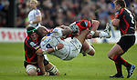 Leo Auva'a gets turned over in the tackle by Robert Sidoli and Dan Lydiate..RaboDirect Pro 12.Newport Gwent Dragons v Leinster..05.05.12.©Steve Pope-Sportingwales
