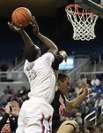 Gorman's Shabazz Muhammad gets fouled by James Herrick of Douglas during a semi-final game in the NIAA 4A State Basketball Championships between Bishop Gorman and Douglas high schools at Lawlor Events Center in Reno, Nev, on Thursday, Feb. 23, 2012. Gorman won 73-38..Photo by Cathleen Allison